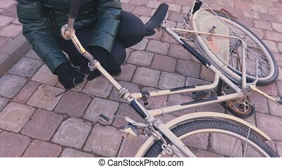 Woman repairing bicycle