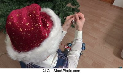 Woman repairing Christmas decorations