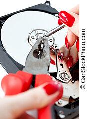 Woman repairing computer HDD