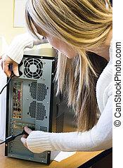 woman repairing computer