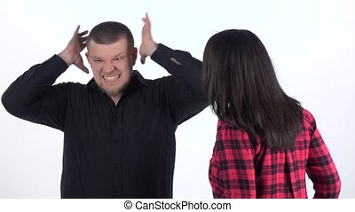Woman reproaches of man and he covers his ears. Slow motion...