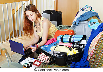 Woman reserving hotel or tickets online