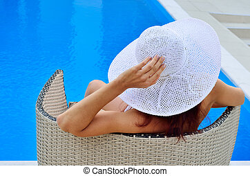 Woman resting at the pool