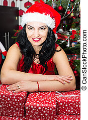 Woman resting hands on Xmas gifts