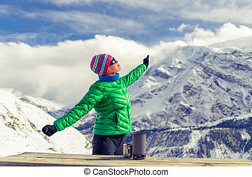 Woman resting in base camp in winter mountains