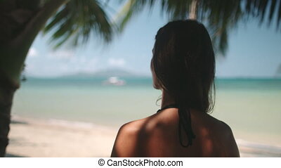 woman resting on philippines tropical seashore