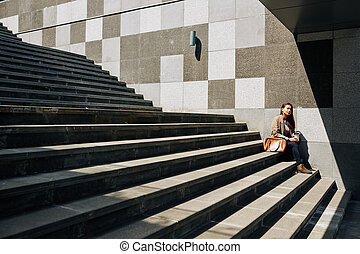 Woman resting on steps