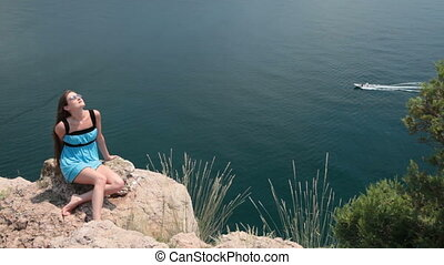 woman resting on the cliff
