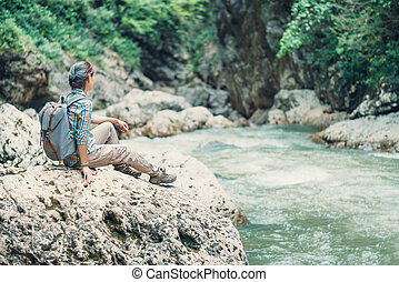 Woman resting on the river bank