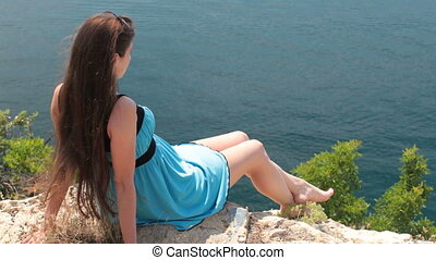 woman resting on top of  mountain
