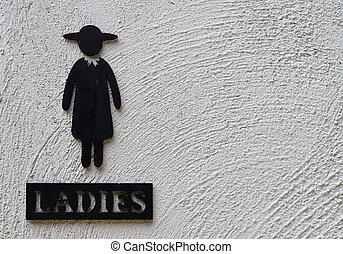 Woman restroom sign
