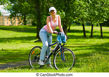 Woman rests on the bike