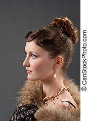 Woman retro revival portrait. girl in boa