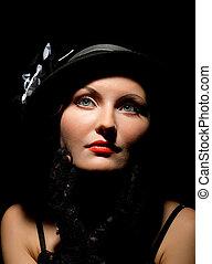 Woman retro revival portrait. girl in hat