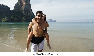 Woman Ride Man Back Turning On Beach, Happy Couple Cheerful Tourists