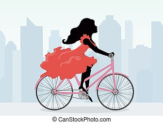 Woman rides a Bicycle on the background of the city