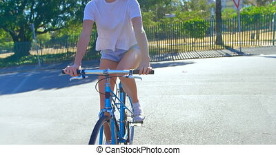 Woman riding a bicycle in the street 4k