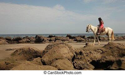 Woman Riding At Beach