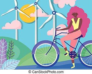 woman riding bike field turbine wind transport energy ecology