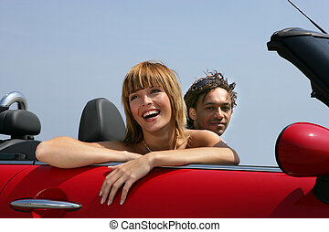 Woman riding in a convertible