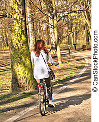 Woman riding on bike