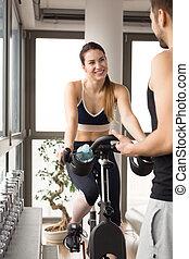 Woman riding on exercisie bike