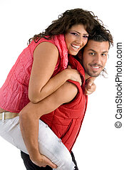 woman riding piggy back on man