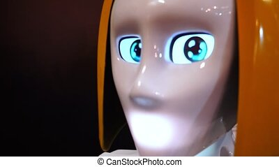 Woman robot looking at the camera