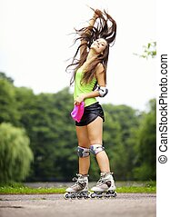woman roller skating sport activity in park - Happy young ...
