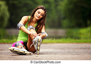 woman roller skating sport activity in park - Happy young...