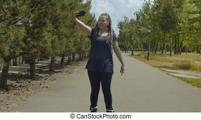 Woman roller streaming video online during ride - Active...