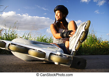 Woman rollerblading - Asian woman on inline rollerblades...
