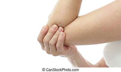 Woman Rubbing and Stretching Elbow - Close up shot of a ...