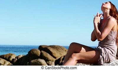 Woman rubbing sunscreen into her skin