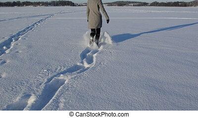 woman run fluffy snow