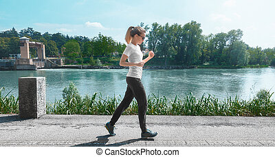 Woman run, running on the river