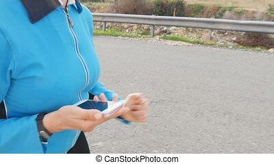 Woman Runner athlete using her smart watch