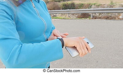 Woman Runner athlete using her smart watch