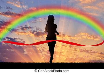 Woman runner crosses the red tape