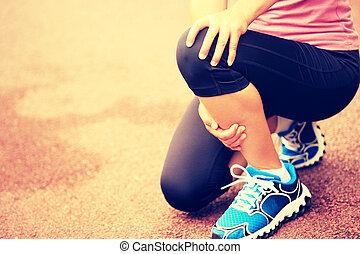woman runner hold her injured knee