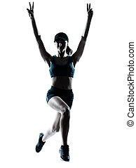 woman runner jogger jumping victorious silhouette - one...