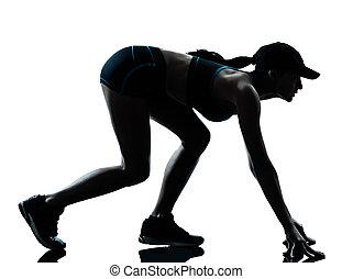 woman runner jogger on the starting block - one caucasian...