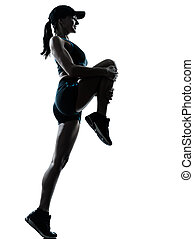 woman runner jogger stretching warm up - one caucasian woman...