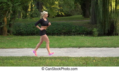 woman runner running in the park
