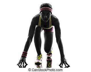 woman runner running on starting blocks silhouette