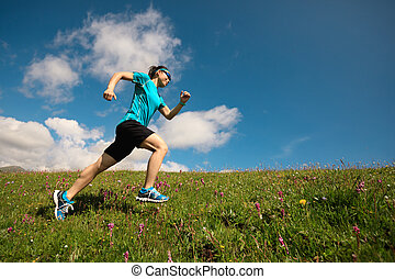 woman runner running up on grassland mountain