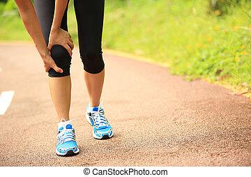 woman runner sports injured knee
