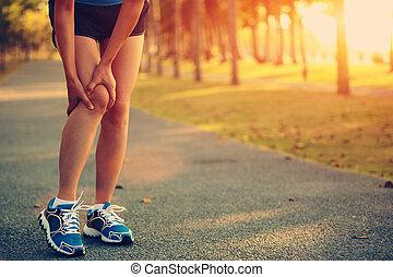 woman runner sports injured leg