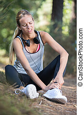 woman runner with ankle joint pain