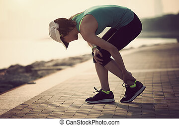 woman runner with sports running knee injury
